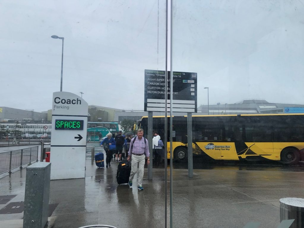 Coach park at Dublin airport in rain