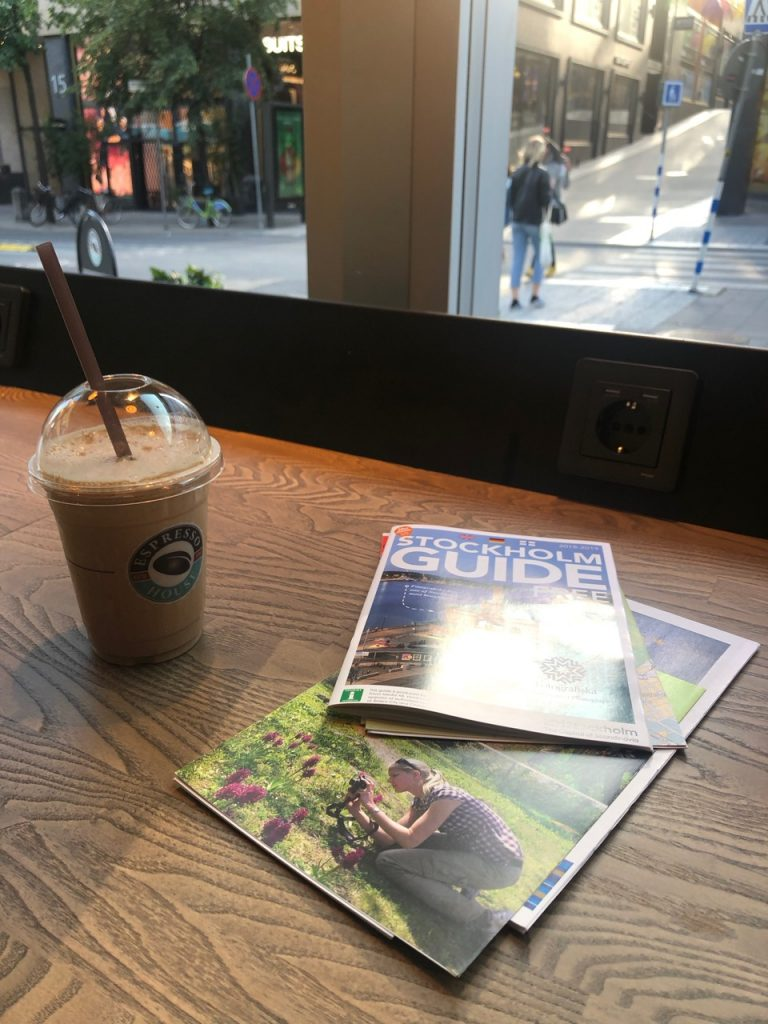 Iced coffee and Stockholm related travel brochures